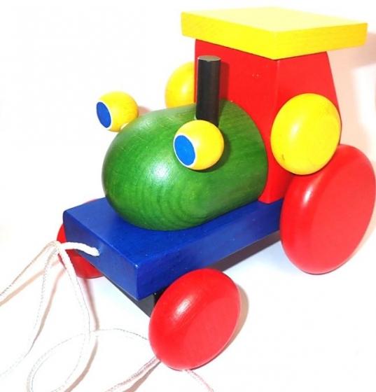 Velký dřevěný barevný klapací traktor