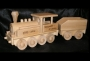 Velká lokomotiva s uhlákem a textovým popisem